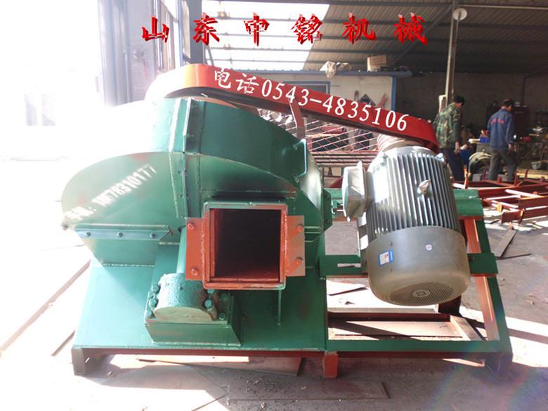斜盘式木材大块机